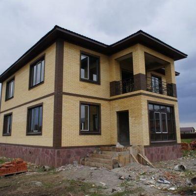 Отделка фасада кирпичного дома